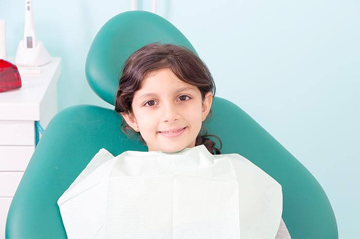 child getting teeth cleaned